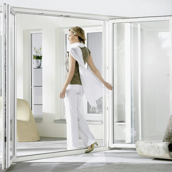 A lady in the room with double glazed upvc french doors.